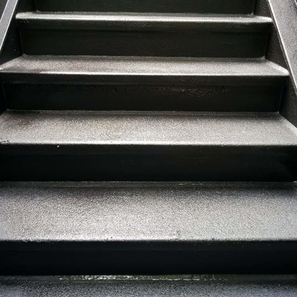 Polyurea Coating with Textured Finish for Grip on Stairs