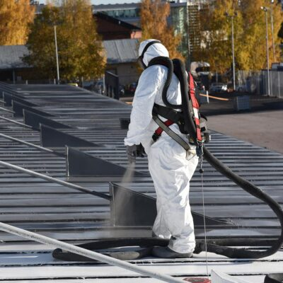 Spray coating applied to roofing area
